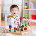 A kid picture playing with toys.