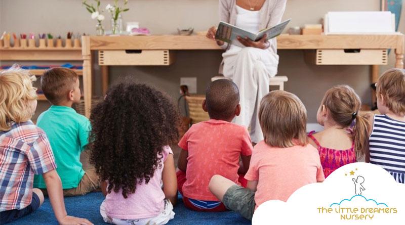 kids-listening-to-their-teacher-story-in-nursery-centre
